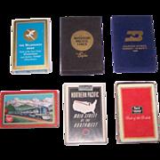 "6 Decks Railroad Cards, $10/ea.: (i) Brown & Bigelow ""Milwaukee Road""; (ii) Liberty ""Missouri Pacific""; (iii) Gemaco ""Burlington Northern""; (iv) USPC ""Missouri Pacific""; (v) Brown & Bigelow ""Northern Pacific""; (vi) Brown & Bigelow ""Rock Island"""
