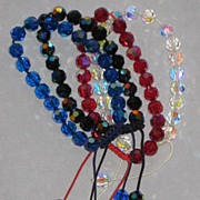 4 Gorgeous Crystal Pull Bracelets in Black, Clear, Blue & Red in Unique Design-1 of 2