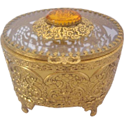 Beautiful Gold Ormolu Oval Covered Jewelry Casket Floral Detail-Beveled Glass and Amber Crystal Top