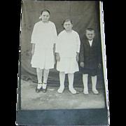 Vintage Postcard of Three Happy Children