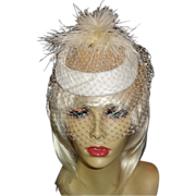 Elegant Off-White Topper with Ostrich Feather Accent.