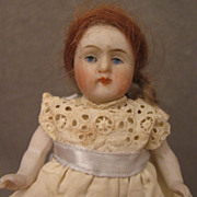 "4"" German All Bisque Doll in Eyelet Dress"