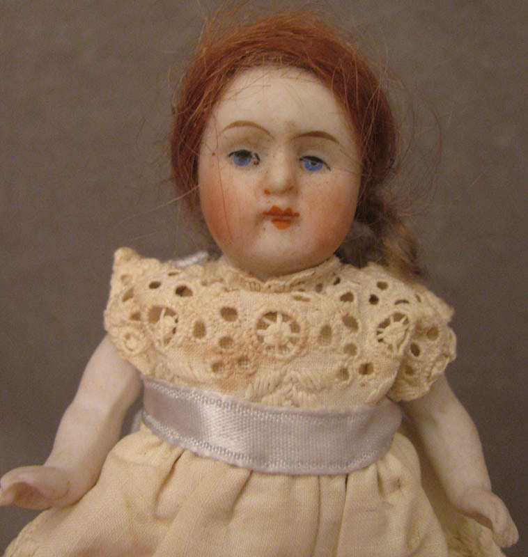 """4"""" German All Bisque Doll in Eyelet Dress"""