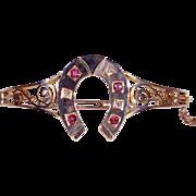 Antique Victorian Ruby and Diamond Horseshoe Bangle Bracelet in 18k Gold