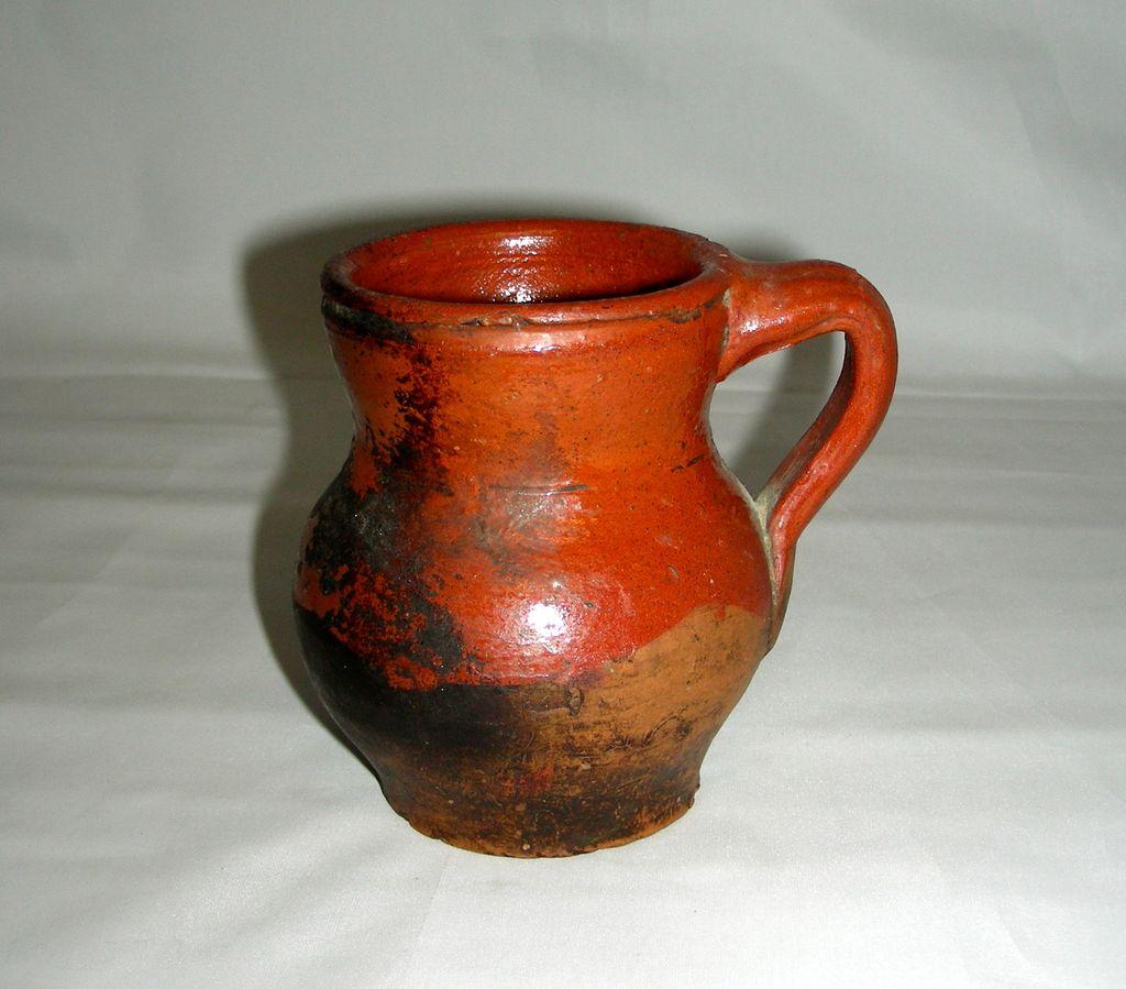 "Miniature 19th Century Widemouthed Redware Jug, 4"" tall"