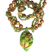 Carved Tree Frog Pendant on Necklace with Intertwined Strands – Peridot – Gold Beads – Harvest Stone
