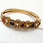 Hinged Bangle Bracelet With Stones of Red, Black and Faux Pearls