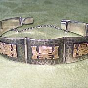 Peruvian Silver and 18 Karat Gold Carved Bracelet